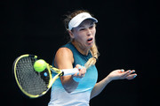 Caroline Wozniacki of Denmark plays a forehand in her second round match against Johanna Larsson of Sweden during day three of the 2019 Australian Open at Melbourne Park on January 16, 2019 in Melbourne, Australia.