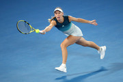 Caroline Wozniacki of Denmark plays a forehand in her third round match against Maria Sharapova of Russia during day five of the 2019 Australian Open at Melbourne Park on January 18, 2019 in Melbourne, Australia.