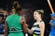 Serena Williams of the United States and Simona Halep of Romania embrace at the net following their fourth round match against Simona Halep of Romania during day eight of the 2019 Australian Open at Melbourne Park on January 21, 2019 in Melbourne, Australia.