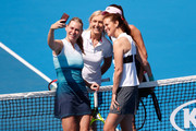 Mary Joe Fernandez of the United States, Barbara Schett of Austria, Martina Navratilova of the United States and Daniela Hantuchova of Slovakia pose for a selfie in their Women's Legends Doubles match during day nine of the 2019 Australian Open at Melbourne Park on January 22, 2019 in Melbourne, Australia.