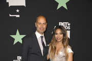 (L-R) Jesse Collins, President and CEO of Jesse Collins Entertainment, and Regina Hall pose in the press room at the 2019 BET Awards on June 23, 2019 in Los Angeles, California.