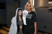 Queen Naija and Mary J. Blige pose backstage at the BET Experience STAPLES Center Concert Sponsored By NISSAN at Staples Center on June 20, 2019 in Los Angeles, California.
