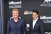 (L-R) William Zabka and Ralph Macchio attend the 2019 Billboard Music Awards at MGM Grand Garden Arena on May 01, 2019 in Las Vegas, Nevada.