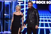 (L-R) Julia Michaels and David Guetta speak onstage during the 2019 Billboard Music Awards at MGM Grand Garden Arena on May 01, 2019 in Las Vegas, Nevada.