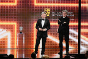 (L-R) Steve Coogan accepts the Charlie Chaplin Britannia Award for Excellence in Comedy Presented by Jaguar Land Rover from John C. Reilly during the 2019 British Academy Britannia Awards presented by Jaguar Land Rover and American Airlines at The Beverly Hilton Hotel on October 25, 2019 in Beverly Hills, California.