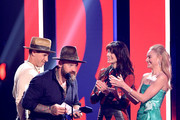 Zac Brown accepts an award from  Michelle Monaghan and Kate Bosworth at the 2019 CMT Music Awards at Bridgestone Arena on June 05, 2019 in Nashville, Tennessee.