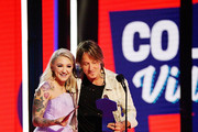 Julia Michaels and Keith Urban accept an award at the 2019 CMT Music Awards at Bridgestone Arena on June 05, 2019 in Nashville, Tennessee.