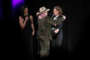 (L-R) Leslie Fram, Tanya Tucker and Brandi Carlile seen onstage during the 2019 CMT Next Women Of Country at CMA Theater at the Country Music Hall of Fame and Museum on November 12, 2019 in Nashville, Tennessee.