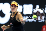 Angelique Kerber of Germany returns a shot against Shuai Zhang of China during women's singles first round match of 2019 China Open at the China National Tennis Center on September 29, 2019 in Beijing, China.