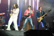 r  Brian Bell, Rivers Cuomo and Scott Shriner of Weezer perform at Coachella Stage during the 2019 Coachella Valley Music And Arts Festival on April 13, 2019 in Indio, California.