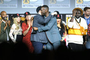 Kevin Feige and Mahershala Ali (C) speak at the Marvel Studios Panel during 2019 Comic-Con International at San Diego Convention Center on July 20, 2019 in San Diego, California.