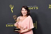 Rachel Bloom poses with the Outstanding Original Music and Lyrics Award for 'Crazy Ex-Girlfriend' in the press room during the 2019 Creative Arts Emmy Awards on September 14, 2019 in Los Angeles, California.