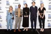 """(L-R) Dede Gardner, Barry Jenkins, Adele Romanski, Jeremy Kleiner, and Sara Murphy pose in the press room with the Best Feature award for the film """"If Beale Street Could Talk"""" during the 2019 Film Independent Spirit Awards on February 23, 2019 in Santa Monica, California."""