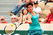 Carla Suarez Navarro of Spain plays a forehand during her ladies singles third round match against Marketa Vondrousova of The Czech Republic  during Day six of the 2019 French Open at Roland Garros on May 31, 2019 in Paris, France.