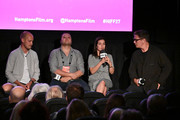 """(L-R) Edward Watts, Hamza Al Kateab, Waad al-Kateab, and Alec Baldwin speak on stage during the Conflict and Resolution – """"For Sama"""" Screening at 2019 Hamptons International Film Festival on October 13, 2019 in East Hampton, New York."""
