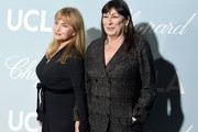 (L-R) Rebecca De Mornay and Anjelica Huston attend the 2019 Hollywood For Science Gala at Private Residence on February 21, 2019 in Los Angeles, California.