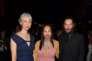 (L-R) Alexandra Grant,  Eva Chow, wearing Gucci, and Keanu Reeves attend the 2019 LACMA Art + Film Gala Presented By Gucci at LACMA on November 02, 2019 in Los Angeles, California.