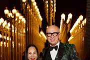 Eva Chow, wearing Gucci (L) and Marco Bizzarri attend the 2019 LACMA Art + Film Gala Presented By Gucci at LACMA on November 02, 2019 in Los Angeles, California.