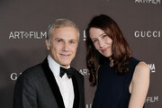 Christoph Waltz (L) and guest attend the 2019 LACMA 2019 Art + Film Gala Presented By Gucci at LACMA on November 02, 2019 in Los Angeles, California.