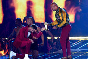 (L-R) Zachary Levi presents Dwayne Johnson with the MTV Generation Award onstage during the 2019 MTV Movie and TV Awards at Barker Hangar on June 15, 2019 in Santa Monica, California.
