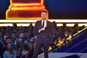 Host, Zachary Levi speaks onstage during the 2019 MTV Movie and TV Awards at Barker Hangar on June 15, 2019 in Santa Monica, California.