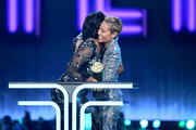 (L-R) Tiffany Haddish presents Jada Pinkett Smith with the MTV Trailblazer Award onstage during the 2019 MTV Movie and TV Awards at Barker Hangar on June 15, 2019 in Santa Monica, California.