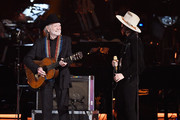 Willie Nelson and Brandi Carlile perform onstage during MusiCares Person of the Year honoring Dolly Parton at Los Angeles Convention Center on February 8, 2019 in Los Angeles, California.