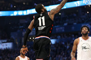 Kyrie Irving #11 of the Boston Celtics and Team LeBron goes up for a shot against Joel Embiid #21 of the Philadelphia 76ers and Team Giannis in the first quarter during the NBA All-Star game as part of the 2019 NBA All-Star Weekend at Spectrum Center on February 17, 2019 in Charlotte, North Carolina.  NOTE TO USER: User expressly acknowledges and agrees that, by downloading and/or using this photograph, user is consenting to the terms and conditions of the Getty Images License Agreement. Mandatory Copyright Notice: Copyright 2019 NBAE