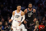 Russell Westbrook #0 (L) of the Oklahoma City Thunder and Team Giannis reacts as Dwyane Wade #3 (R) of the Miami Heat and Team LeBron looks on in the second quarter during the NBA All-Star game as part of the 2019 NBA All-Star Weekend at Spectrum Center on February 17, 2019 in Charlotte, North Carolina.  NOTE TO USER: User expressly acknowledges and agrees that, by downloading and/or using this photograph, user is consenting to the terms and conditions of the Getty Images License Agreement. Mandatory Copyright Notice: Copyright 2019 NBAE