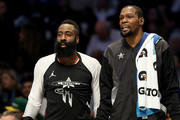 James Harden #13 of the Houston Rockets and teammate Kevin Durant #35 of the Golden State Warriors and Team LeBron watch on from the bench during the NBA All-Star game as part of the 2019 NBA All-Star Weekend at Spectrum Center on February 17, 2019 in Charlotte, North Carolina.  NOTE TO USER: User expressly acknowledges and agrees that, by downloading and/or using this photograph, user is consenting to the terms and conditions of the Getty Images License Agreement.