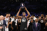 Kevin Durant #35 of the Golden State Warriors and Team LeBron celebrates with the MVP trophy after their 178-164 win over Team Giannis during the NBA All-Star game as part of the 2019 NBA All-Star Weekend at Spectrum Center on February 17, 2019 in Charlotte, North Carolina. NOTE TO USER: User expressly acknowledges and agrees that, by downloading and/or using this photograph, user is consenting to the terms and conditions of the Getty Images License Agreement. Mandatory Copyright Notice: Copyright 2019 NBAE
