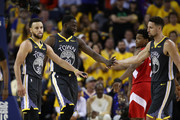 Stephen Curry #30, Draymond Green #23 and Klay Thompson #11 of the Golden State Warriors react against the Toronto Raptors in the second half during Game Four of the 2019 NBA Finals at ORACLE Arena on June 07, 2019 in Oakland, California. NOTE TO USER: User expressly acknowledges and agrees that, by downloading and or using this photograph, User is consenting to the terms and conditions of the Getty Images License Agreement.