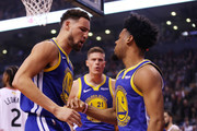 Klay Thompson #11 and Quinn Cook #4 of the Golden State Warriors celebrate the play against the Toronto Raptors in the second quarter during Game One of the 2019 NBA Finals at Scotiabank Arena on May 30, 2019 in Toronto, Canada. NOTE TO USER: User expressly acknowledges and agrees that, by downloading and or using this photograph, User is consenting to the terms and conditions of the Getty Images License Agreement.