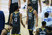 Stephen Curry #30 and Quinn Cook #4 of the Golden State Warriors celebrate the basket against the Toronto Raptors in the first half during Game Six of the 2019 NBA Finals at ORACLE Arena on June 13, 2019 in Oakland, California. NOTE TO USER: User expressly acknowledges and agrees that, by downloading and or using this photograph, User is consenting to the terms and conditions of the Getty Images License Agreement.