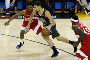 Klay Thompson #11 of the Golden State Warriors is defended by Kyle Lowry #7 of the Toronto Raptors in the second half during Game Six of the 2019 NBA Finals at ORACLE Arena on June 13, 2019 in Oakland, California. NOTE TO USER: User expressly acknowledges and agrees that, by downloading and or using this photograph, User is consenting to the terms and conditions of the Getty Images License Agreement.