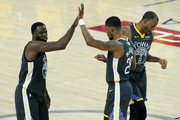 Andre Iguodala #9 of the Golden State Warriors celebrates with Draymond Green #23 and Alfonzo McKinnie #28 against the Toronto Raptors during Game Six of the 2019 NBA Finals at ORACLE Arena on June 13, 2019 in Oakland, California. NOTE TO USER: User expressly acknowledges and agrees that, by downloading and or using this photograph, User is consenting to the terms and conditions of the Getty Images License Agreement.
