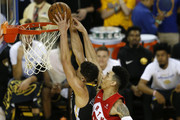 Klay Thompson #11 of the Golden State Warriors is fouled by Danny Green #14 of the Toronto Raptors in the second half during Game Six of the 2019 NBA Finals at ORACLE Arena on June 13, 2019 in Oakland, California. NOTE TO USER: User expressly acknowledges and agrees that, by downloading and or using this photograph, User is consenting to the terms and conditions of the Getty Images License Agreement.