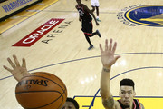 Quinn Cook #4 of the Golden State Warriors attempts a shot past Kyle Lowry #7 and Danny Green #14 of the Toronto Raptors in the second half during Game Three of the 2019 NBA Finals at ORACLE Arena on June 05, 2019 in Oakland, California. NOTE TO USER: User expressly acknowledges and agrees that, by downloading and or using this photograph, User is consenting to the terms and conditions of the Getty Images License Agreement.