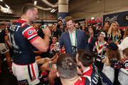 Steve Smith shares a beer with Roosters captain Boyd Cordner and Roosters players in the changing room  following the Roosters victory in the 2019 NRL Grand Final match between the Canberra Raiders and the Sydney Roosters at ANZ Stadium on October 06, 2019 in Sydney, Australia.