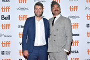 """(L-R) Carthew Neal and Taika Waititi attend the """"Jojo Rabbit"""" premiere during the 2019 Toronto International Film Festival at Princess of Wales Theatre on September 08, 2019 in Toronto, Canada."""