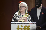 Gary Oldman and Shamier Anderson present the TIFF Tribute Actor Award to Meryl Streep (L) during the 2019 Toronto International Film Festival TIFF Tribute Gala at The Fairmont Royal York Hotel on September 09, 2019 in Toronto, Canada.