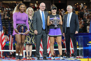 Bianca Andreescu (R) of Canada celebrates with the championship trophy alongside runner up Serena Williams (L) of the United States, USTA President Robert Galbraith (C) and Tracy Austin (2nd L) during the trophy presentation ceremony after the Women's Singles final on day thirteen of the 2019 US Open at the USTA Billie Jean King National Tennis Center on September 07, 2019 in the Queens borough of New York City.