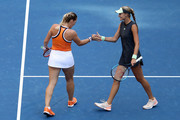Timea Babos of Hungry and Kristina Mladenovic of France celebrates a point during their Women's Doubles quarterfinal match against Ashleigh Barty of Australia and Victoria Azarenka of Belarus on day nine of the 2019 US Open at the USTA Billie Jean King National Tennis Center on September 03, 2019 in the Queens borough of New York City.
