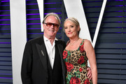 Peter Fonda and Margaret DeVogelaere attend the 2019 Vanity Fair Oscar Party hosted by Radhika Jones at Wallis Annenberg Center for the Performing Arts on February 24, 2019 in Beverly Hills, California.