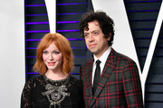 Christina Hendricks (L) and Geoffrey Arend attend the 2019 Vanity Fair Oscar Party hosted by Radhika Jones at Wallis Annenberg Center for the Performing Arts on February 24, 2019 in Beverly Hills, California.