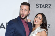 Pablo Schreiber and Melissa Barrera attend the 2019 Winter TCA Tour - STARZ Red Carpet Event at 71Above on February 12, 2019 in Los Angeles, California.