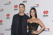 Actors Eric Winter (L) and Roselyn Sanchez attend the 2019 iHeartRadio Music Festival at T-Mobile Arena on September 21, 2019 in Las Vegas, Nevada.