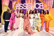 (L-R) Essence Ventures Founder & Chairman Richelieu Dennis, honoree Angelica Ross, honoree Lashana Lynch, honoree Janet Mock, honoree Niecy Nash, honoree Hailie Sahar, honoree Mj Rodriguez, honoree Melina Matsoukas, Essence Chief Content & Creative Officer Moana Luu, and Essence CEO Michelle Ebanks pose onstage during the 2020 13th Annual ESSENCE Black Women in Hollywood Luncheon at Beverly Wilshire, A Four Seasons Hotel on February 06, 2020 in Beverly Hills, California.