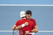 Novak Djokovic of Serbia hugs Denis Shapovalov after winning match point during his quarter final singles match against Denis Shapovalov of Canada during day eight of the 2020 ATP Cup at Ken Rosewall Arena on January 10, 2020 in Sydney, Australia.