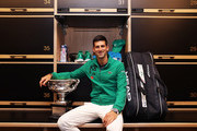 Novak Djokovic of Serbia poses with the Norman Brookes Challenge Cup in the locker room after winning the Men's Singles Final against Dominic Thiem of Austria on day fourteen of the 2020 Australian Open at Melbourne Park on February 03, 2020 in Melbourne, Australia.